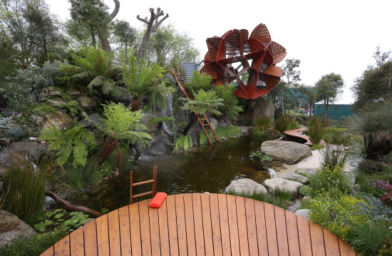 Trailfinders Australian Garden at Chelsea 2013  showing deck over the billabong with the waratah-inspired studio in the background