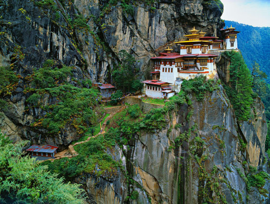 Clinging precipitously to a sheer mountain-side, the Taktsang Palphug Monastery is known as the 'Tiger's nest'. Photo – Photopictures / Shutterstock.com